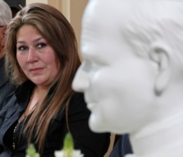 Costa Rica's Floribeth Mora looks at a bust of Pope John Paul II while giving her account of a miracle attributed to John Paul, during a press conference at the Archbishop's office in San Jose, Costa Rica, July 5, 2013.