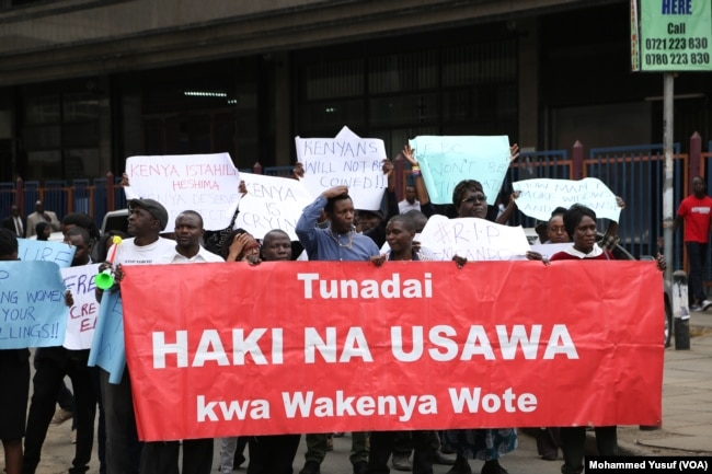 Several dozen protesters march to the electoral commission offices demanding an investigation into the murder of Independent Electoral and Boundaries Commission senior official Chris Msando, in Nairobi, Aug. 1, 2017.