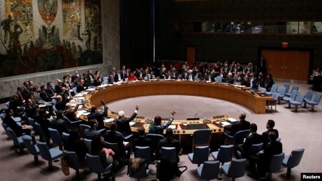 The United Nations Security Council votes on resolution on humanitarian aid for Syria at U.N. headquarters in New York, Feb. 22, 2014.
