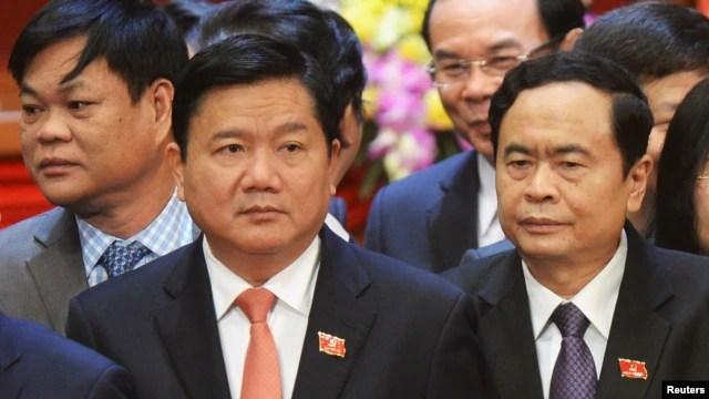 Bí thư thành ủy TP.HCM Đinh La Thăng (trái).