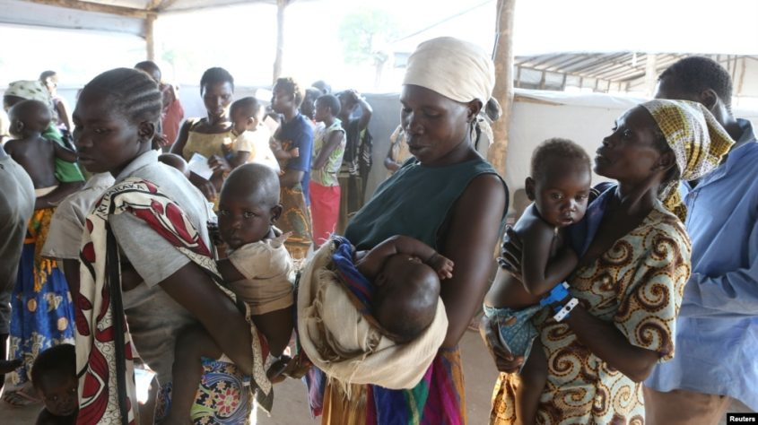 FILE - Women who fled fighting in South Sudan wait with their children for the immunization of their children on arrival at Bidi Bidi refugee's resettlement camp near the border with South Sudan, in northern Uganda Dec. 7, 2016.