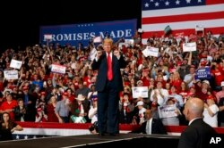 President Donald Trump arrives to speak at a rally at the Show Me Center on Monday, November 5, 2018, at Cape Girardeau, Mo .. (AP Photo / Carolyn Kaster).