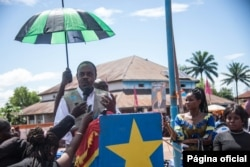 Dr. Oly Ilunga Kalenga, minister of health of the Democratic Republic of Congo, addresses residents at the town all of Mbandaka, May 21, 2018, during the launch of the Ebola vaccination campaign.