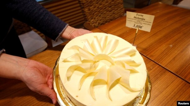 FILE - A cake named after Melania Trump is seen at coffee shop in her hometown Sevnica, Slovenia, Dec. 1, 2016.