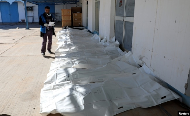 Bags containing dead bodies of migrants who were killed in a truck crash, are seen at a hospital in Bani Walid town, Libya, Feb. 14, 2018.
