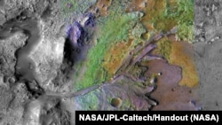 FILE: Shapes made of water and sediment can be seen in the Jezero Crater on Mars, a potential landing site for the Mars 2020 Rover, in this deceptive color image taken by NASA, published May 15, 2019 and received November 15, 2019. NASA / JPL-Caltech / Handheld