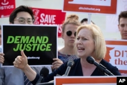 Sen. Kirsten Gillibrand, D-N.Y., joins activists at the Supreme Court in Washington, June 28, 2018.