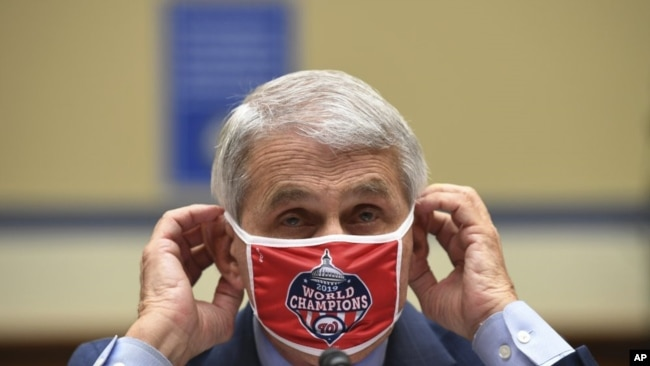 Dr. Anthony Fauci, director of the National Institute for Allergy and Infectious Diseases, adjusts his face mask during a House Subcommittee on the Coronavirus crisis hearing, Friday, July 31, 2020 on Capitol Hill in Washington. (Kevin Dietsch/Pool via AP