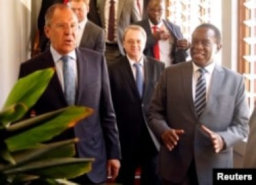FILE: Zimbabwean President Emmerson Mnangagwa walks with Russian Foreign Minister Sergey Lavrov before their meeting in Harare, Zimbabwe, March 8, 2018.