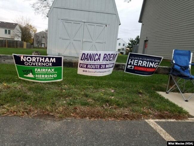 En Virginia carteles publicitarios en todos los barrios promueven a los candidatos republicanos y demócratas para gobernador, vicegobernador, fiscal estatal y delegados. Nov. 7, 2017