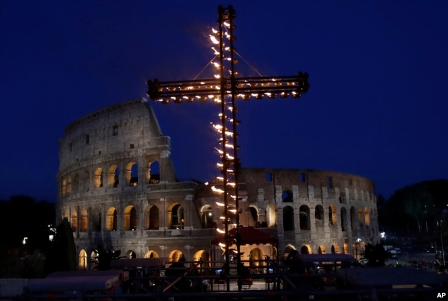 A view of the ancient Colosseum in Rome, April 14, 2017. Pope Francis presided over the Via Crucis (Way of the Cross) torchlight procession on Good Friday in front of Rome's Colosseum.