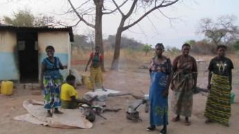 Women waiting near rural health clinic- No Waiting shelter!