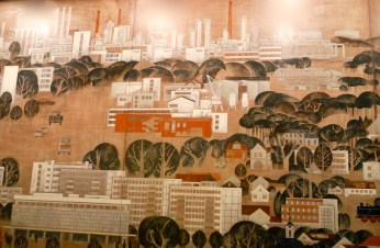 "The oil refinery looms over the city in the mural ""The New Schwedt"" (photo: author)."