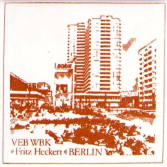 """A souvenir ceramic tile presented to members of the """"Fritz Heckert"""" People's Own Housing Construction Combine (photo: author)."""
