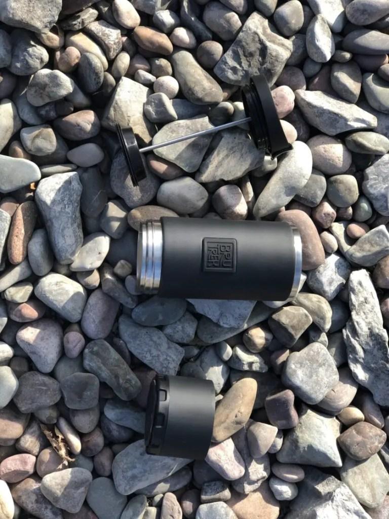 BruTrek press unassembled on a bed of rocks.