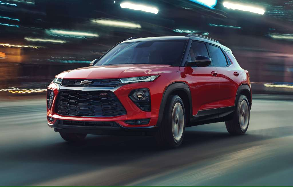 The 2021 Chevy Trailblazer AWD RS driving down a city road with cool lighting.