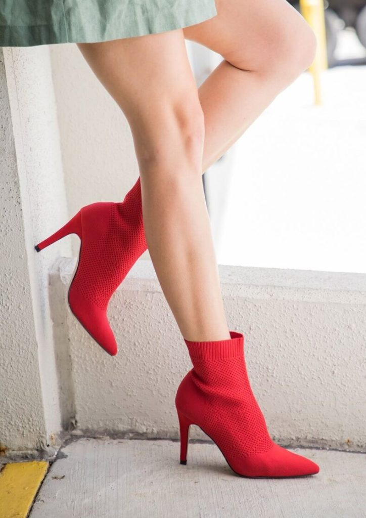 A woman wearing her bright red MIA McKinley Stiletto Booties.