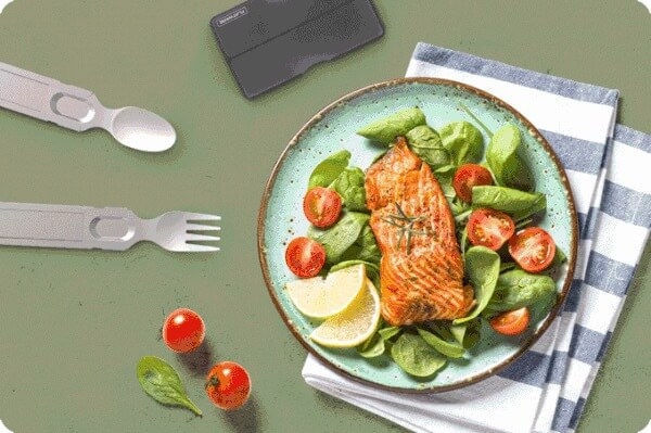 A tasty plate of salmon salad with the GoSun flatware in use on the table beside it.