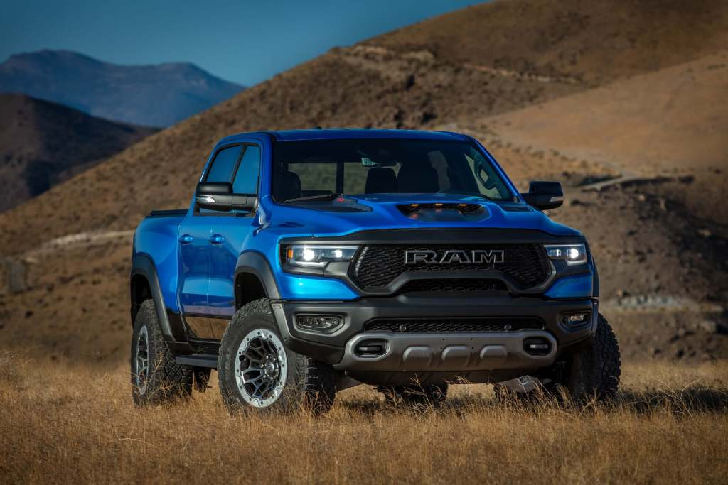 The 2021 Ram 1500 TRX in field by the mountains.