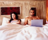 Couple Looking Disinterested in Bed