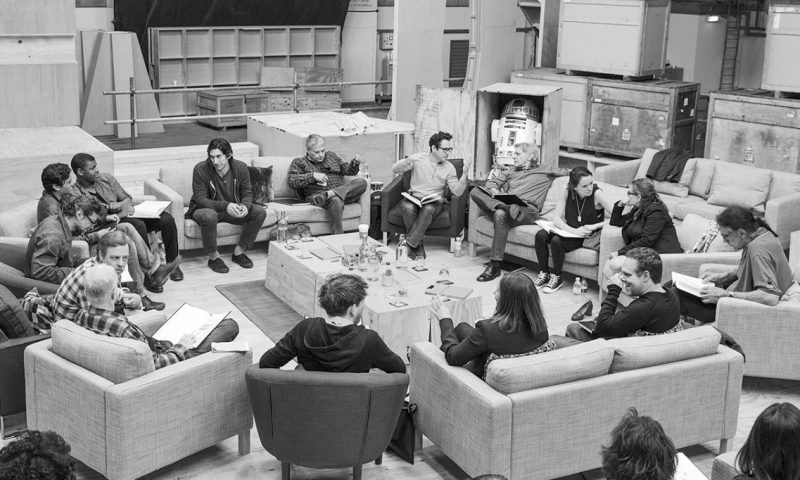 Writer/Director/Producer J.J Abrams (top center right) at the cast read-through of Star Wars Episode VII at Pinewood Studios with (clockwise from right) Harrison Ford, Daisy Ridley, Carrie Fisher, Peter Mayhew, Producer Bryan Burk, Lucasfilm President and Producer Kathleen Kennedy, Domhnall Gleeson, Anthony Daniels, Mark Hamill, Andy Serkis, Oscar Isaac, John Boyega, Adam Driver and Writer Lawrence Kasdan. Copyright and Photo Credit: David James.