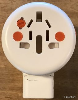 A multi-port pass-through outlet on the front of the Twist+ World Adapter DUO