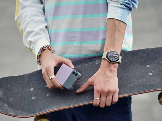 A skater with a lavender Samsung Galaxy Z Flip3; not gonna lie — it's pretty cute