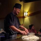 A hibachi chef making fried rice.