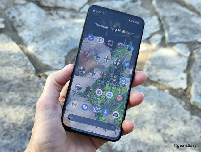 The Google Pixel 5a in hand.