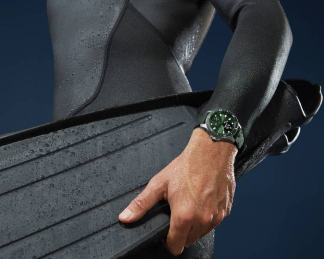 Withings ScanWatch Horizon in green on a man's wrist.