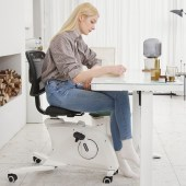 Woman sitting on a Flexispot Sit2Go 2-in-1 Fitness Chair.