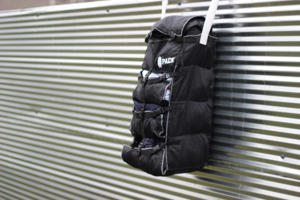 pack gear on fence