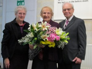 Ann, one of our flower arrangers presenting flowers to Ethel and Ben