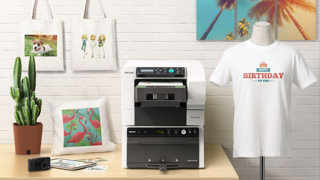 16688d942 At CES 2018, Ricoh showed off its new Ri100 T-Shirt Printer which is  perfect for your small businesses or anyone who is crazy about printing  their own ...