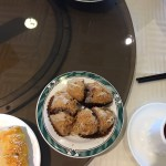Deep fried Taro Puffs served on a blue trimmed circular white dish.