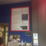 Picture of Side Chick menu against wall behind their service counter.