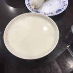 Hot soybean milk in a white bowl.