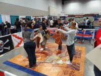 Giant Tsuro! It's a lot harder to plan moves when you have to stand on the board.
