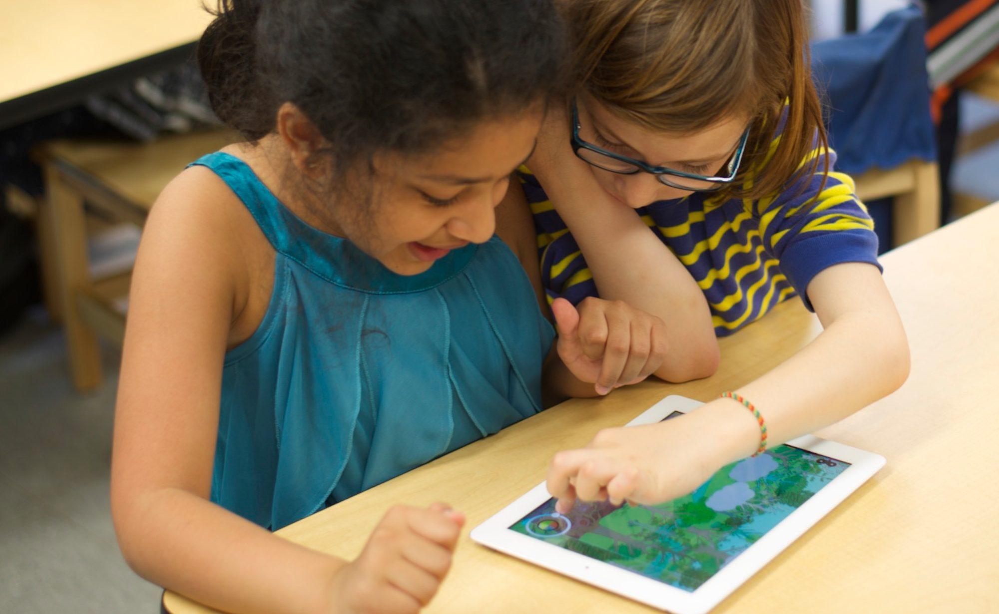 Kids playing Tinybop Plants. Photo Copyright Tinybop 2014
