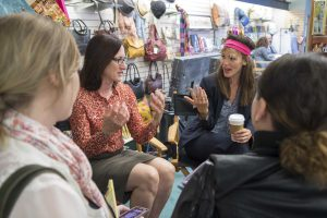 "Lisa Henson and Jennifer Garner (wearing a headband to create the appearance of extreme ""helmet hair"") answer questions from a group of bloggers."