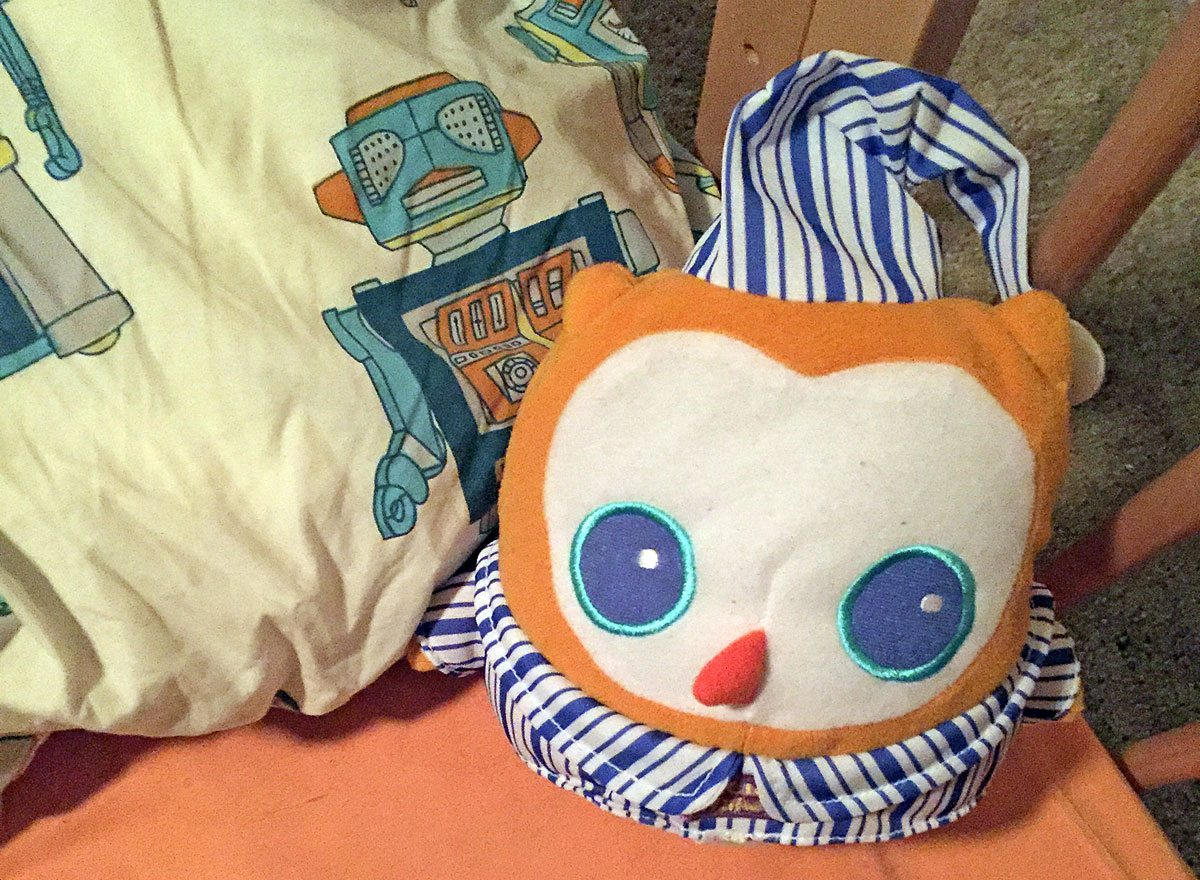 OK to Wake! Owl lounging in our crib.