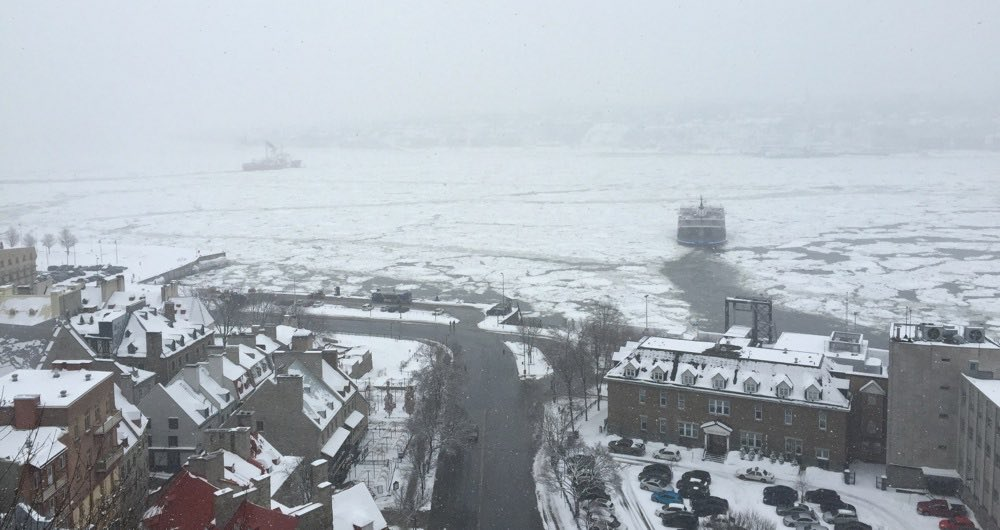 boats break through the ice of the St. Lawrence river