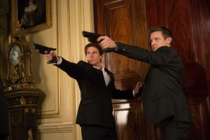Ethan Hunt (Tom Cruise) and William Brandt (Jeremy Renner) shoot their way out of a problem. © 2015 Paramount