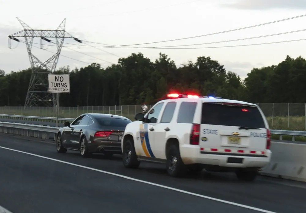 """""""New Jersey State Police Traffic Stop"""" by versageek - http://flickr.com/photos/versageek/7633127888/. Licensed under CC BY-SA 2.0 via Commons - https://commons.wikimedia.org/wiki/File:New_Jersey_State_Police_Traffic_Stop.jpg#/media/File:New_Jersey_State_Police_Traffic_Stop.jpg"""