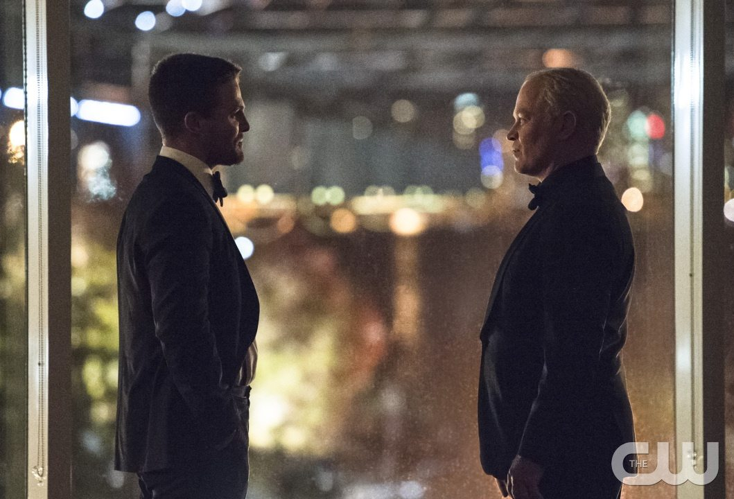 "Arrow -- ""Brotherhood"" -- Image AR407B_275b.jpg -- Pictured (L-R): Stephen Amell as Oliver Queen and Neal McDonough as Damien Darhk -- Photo: Cate Cameron/The CW -- �© 2015 The CW Network, LLC. All Rights Reserved."