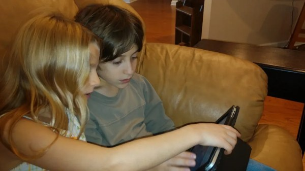 My daughter advising her big brother on his coding choices.