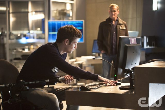 "The Flash -- ""Gorilla Warfare"" -- Image FLA207B_0052b.jpg -- Pictured (L-R): Grant Gustin as Barry Allen and John Wesley Shipp as Henry Allen -- Photo: Cate Cameron/The CW -- �© 2015 The CW Network, LLC. All rights reserved."