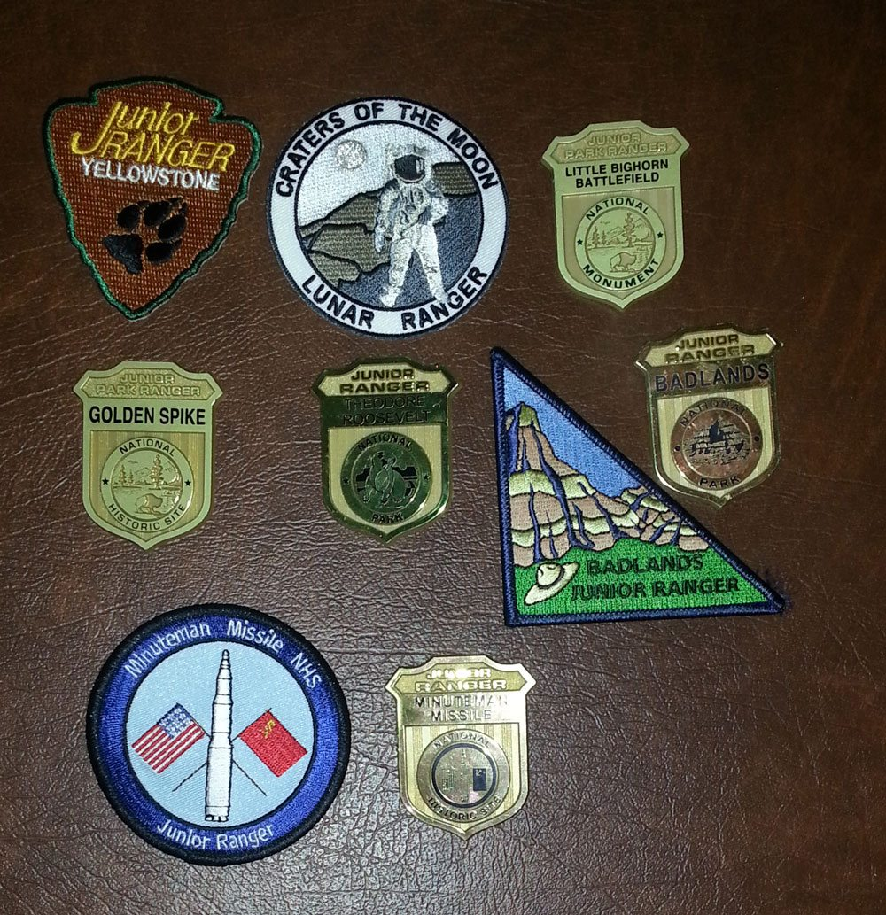 One particularly good road trip's haul of Junior Ranger badges and patches. Photo by Rob Huddleston