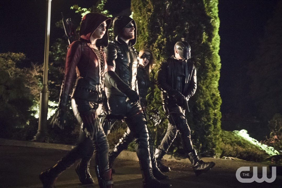 "Arrow -- ""Blood Debts"" -- Image AR410a_0114b.jpg -- Pictured (L-R): Willa Holland as Speedy, Stephen Amell as The Arrow, Katie Cassidy as Black Canary and David Ramsey as John Diggle -- Photo: Katie Yu/ The CW -- �© 2015 The CW Network, LLC. All Rights Reserved."