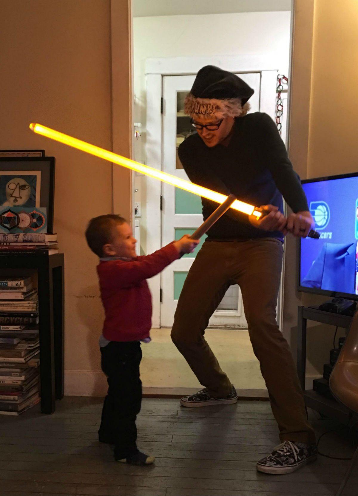Proper light saber technique: don't hit the TV! Photo by Sarah James